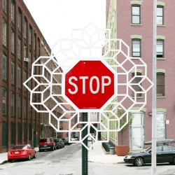 Aakash Nihalani's latest piece of street art;  geometric sculpture additions to a Brooklyn stop sign.