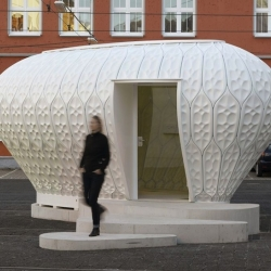 The complex structure of The Cocoon_FS pavilion by Pohl Architects was constructed from leaf-like panels of fiber-reinforced polymer. Its translucent shell admits light during the day and illuminates its surroundings at night.