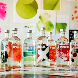 Absolut redesigns all of its bottles with a new 'splash of paint' like feel...