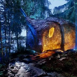 The solar-powered off-grid cabin is owned and designed by Maartje Lammers and Boris Zeisser of 24H Architecture as a family summer vacation retreat in southern Sweden's Glaskogen nature reserve. Dubbed Dragspelhuset or Accordion House by locals.