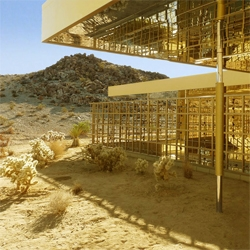 Acido Dorado: Gold paint and reflective materials blend this house with the California desert. Designed by Robert Stone, the house is sunken to benefit from the thermal mass, with interior open spaces to help cool down.