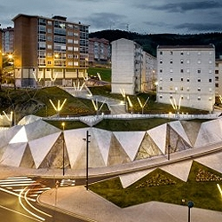 A complex topography designed by ACXT reclaims an isolated piece of land within the city, turning it into a rich urban space for Bilbao, Spain.