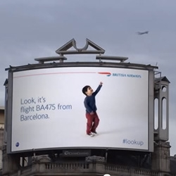 British Airways - #lookup in Piccadilly Circus! Brilliant billboard where the kid looks up and points at the planes as they fly by and actually knows where they are headed!