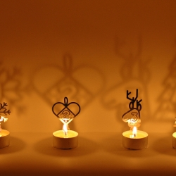 "For Advent: Creatables is a network of designers and engineers. Reuse your candle cups of home, upgrade to the ""clip-ons""! Candle holder creates a beautiful shadow on the wall when lit. Made in Sweden by metal waste."