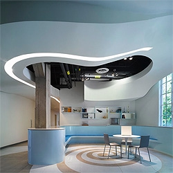 An old buildings gets a new life with fluid interiors designed by JFAK. The building houses the new Graduate Aerospace Laboratories at the California Institute of Technology, and the futuristic interiors fit with the hi tech research going inside.