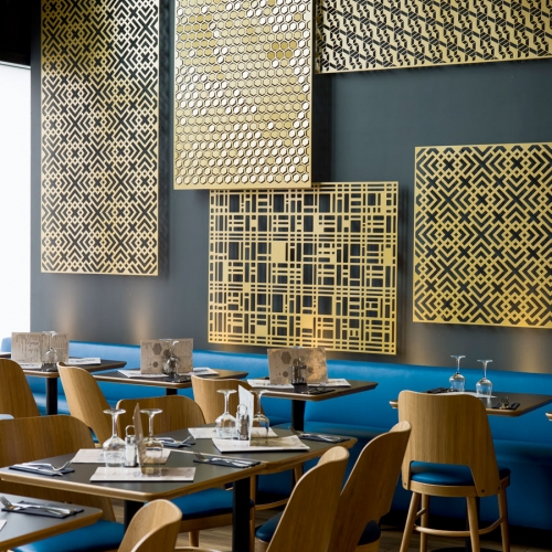 Architect Stephane Ducroix designed the new Café Fratellini in the north of Paris working with Dampere's beautiful metal sheets to builda wall decor of mixing patterns and lights.