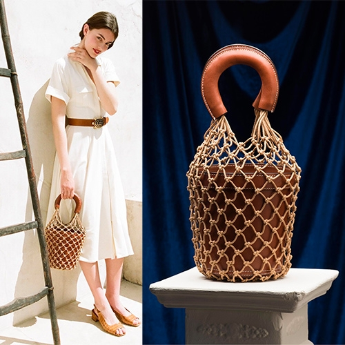 "Staud Moreau Bucket Bag - ""The beautiful brown calf leather bucket sits inside a netting with matching leather handles and comfortable grip."" It's like a leather flower pot hanging in macramé!"