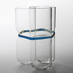 Polish designer Agnieszka Bar creates these great glass vases which are held together with coloured rubber bands.