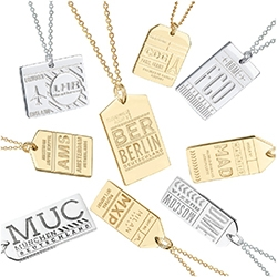 My Jet Set Candy Luggage Tag Charms with Airport Codes of various cities.