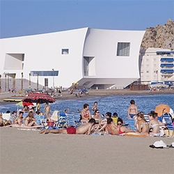 The recently completed Aguilas Auditorium, a pitched cube in front of the ocean. By Estudio Barozzi Veiga.