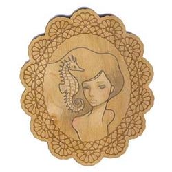 Audrey Kawasaki's mini laser engraved wooden ovals with drawings that were part of a goodie bag are just adorable ~ see a selection of them close up!
