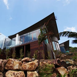 Omiros One Architecture designed this five bedroom luxury residence that commands endless ocean views form atop a steeply inclined site on Hamilton Islands in the heart of Australia's Great Barrier Reef.
