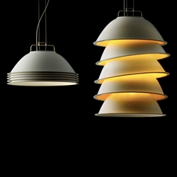 The suspended lamp 5 pack  by Alex Schmid can be changed from one light configuration to another. If all five reflectors sit inside one another, all light is directed downward.