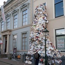 Spanish artist Alicia Martin's latest book sculpture pours out of the Meermaano Museum in the Hague as part of this year's Paper Biennial.