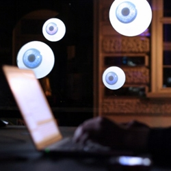 All Eyes on You is projection based installation by Britzpetermann. Different size eye balls follow people at they pass by the store-front. A clever, simple installation with great results.