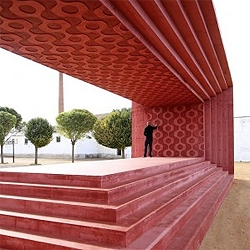 Spanish architects Enproyecto recently completed the monument for director Pedro Almodovar: A red concrete structure which presents a  framed view of the landscape.