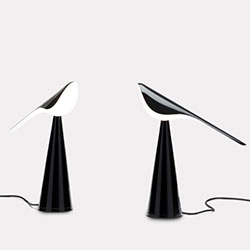 Tiki Table Lamp by Established & Sons. The stunning bird is created by the acrylic shade balanced above a formed metal base.