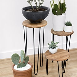 Aldama Side Tables - handcrafted in Mexico by The Coyoacán Design Studio. Made of Mexican parota wood and black steel.