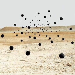 Black balloons captured in the desert by photographer Andrea Galvani