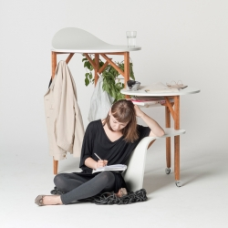Woody is a single work space from Sördesign that can both spread out across the room and retreat into a slim, space saving column. It has three connected levels that want to be conquered and request its user to stay in motion.