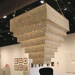 The Anna Marie Chandelier  is the creation of Michigan based designer Michele Dugree.  Constructed of 5,600 translucent porcelain squares, the chandelier measures 4'x4'x4'.