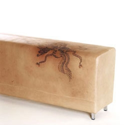 Polka teams up with tattoo artist Gert Kowarzik to make a series of tattooed leather furniture