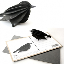 Lovi Postcard - Bird These beautiful wooden cards by Anne Paso of Finland (Lovi) come to life! You can send this flat-packed bird to a friend and allow them the fun of assembling! Set up like a postcard so you can leave a message.