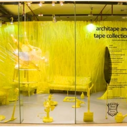 Bangkok- Everyday use, everyone's life, from yesterday to nowadays is an window exhibit at Bangkok Art and Culture Centre by Anon Pairot. By only using yellow color's architape & regular tape, everyday use stuffs are wrapped and displayed.