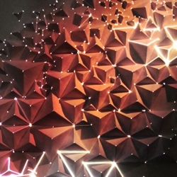 AntiVJ member, Joanie Lemercier, maps light projections onto a 3D origami wall.