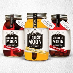 Junior Johnson's Midnight Moon ~ moonshine! Adorable branding and packaging... and flavors like APPLE PIE! and Cherry and Strawberry.