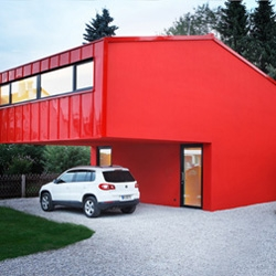 "The House V designed by Jakob Bader is a large house on a small site. It is very red on the outside and very rough inside. The neighbours call it ""the fire department""."
