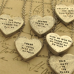 Adorable! Erica Weiner Sweetheart Necklaces ~ found from the 70s and waiting for the inscription of your choice. Choose your words wisely. (or you can get the lyric pre-made versions)