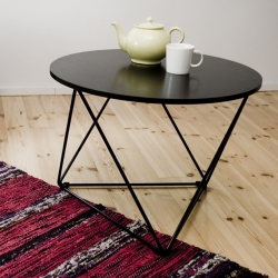 Okto table: one round plywood table-top, three metal triangles, three plastic fittings. Lightweight but strong octahedron shaped frame structure can be taken apart easily and put away when not in use. By  Arttu Kuisma.