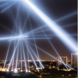 Beams of light across Philly's skyline converge and move interpreting voice messages in a luminous public artwork