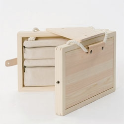 The Atelier Book Chair by Kana Nakanishi is a wooden children's drawing case that opens out into a stool.
