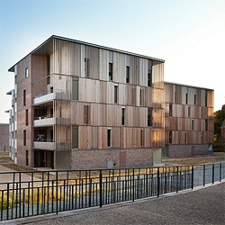 Beautiful low rise wooden buildings for a new social housing complex in Rennes, France. Designed by Atelier du Pont.