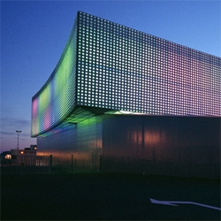 Le Prisme is a colorful structure, a  new venue for theatre, concerts, fairs and sports events. Designed by Brisac Gonzalez.