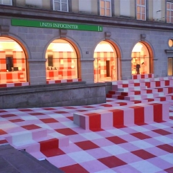 Maybe the first time in the architectural history that the red-and-white checkered tablecloth is used as a symbol of hospitality.