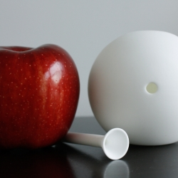 awmoo, a new elegant and sophisticated smoking device hand made out of bone china in the shape of a sphere.