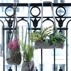 Hanging Gardens from Az & Mut are cloth bags that can hold your plants and be easily hung from your balcony.