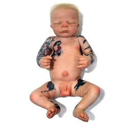 Drill Baby is a lifelike newborn covered with tattoos that tells the tragic story of the BP Oil Spill by artist Jason Clay Lewis.