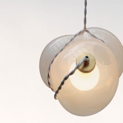 Bundle by Brooke Woosley is a glassblown pendant lamp that was inspired by sloppily tied newspapers held together by twine.