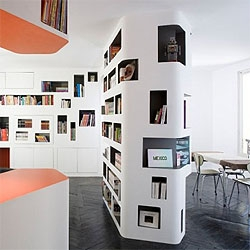 French architects H2o converted an old apartment in Paris into a new open space, organized through new wall furniture.