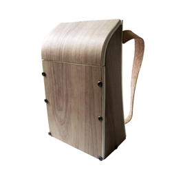 The Horse in Motion - A flatpack walnut backpack that plays with the design of knock down/ flat pack furniture. Features cabinetry hardware, allowing flat-pack ability and easy portability. Ready to assemble.