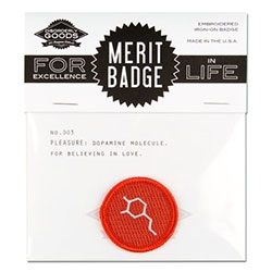 Disorderly Merit Badge for Pleasure - it's the chemical structure for Dopamine! (There's also a Happiness badge that has seratonin on it)