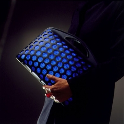 Blue Ether bag, designed by Robert Foster of Fink Design. I love the combination of water-formed (?) aluminium and blue rubber