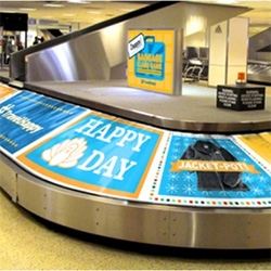 Zappos has decided to bring a bit of fun to the harried commute by turning the baggage claim at George Bush Intercontinental Airport in Houston into a pop-up Wheel of Fortune-type game.