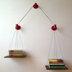 Cush Design Studio's  Balance Bookshelf is hand-made and designed to keep read books on one side and unread on the other.