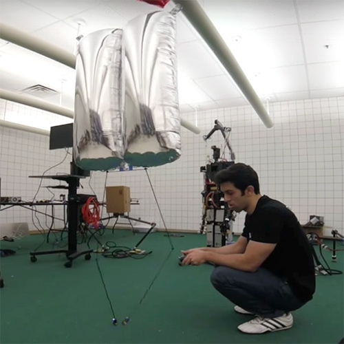 BALLU: Buoyancy Assisted Lightweight Legged Unit. By Sepehr Ghassemi and Dennis Hong at UCLA's RoMeLa (Robotics and Mechanisms Laboratory). Fascinating to watch this balloon robot with flamingo legs walk, hop, dance, and more.