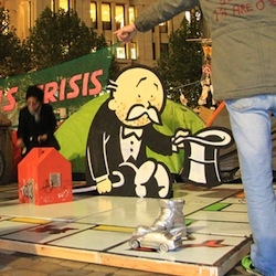Bansky creates art for the Occupy London Movement.